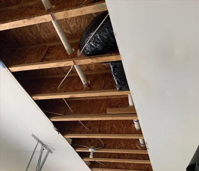 cut out ceiling showing studs with no insulation