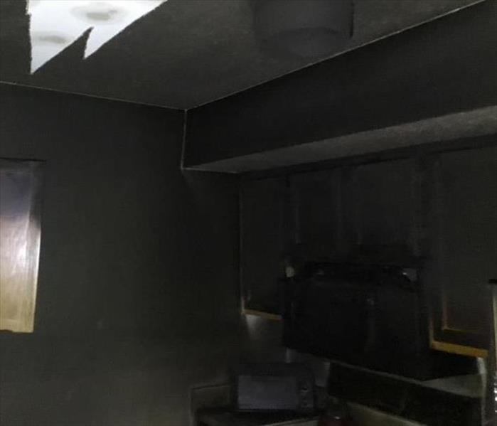 Kitchen covered in soot from fire