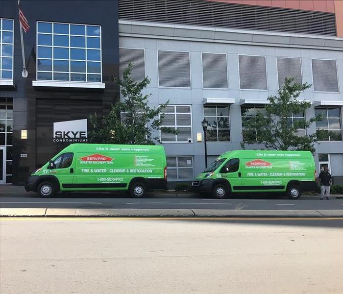 Two Servpro Dodge Promaster Vans out front of a commerical building Skye Condominiums in Charlotte, NC.